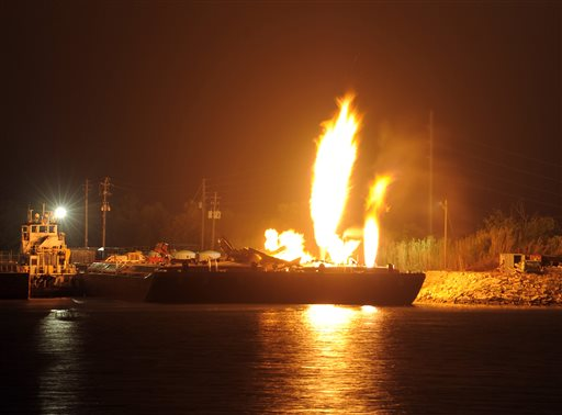 Fire burns aboard two fuel barges along the Mobile River after explosions sent three workers to the hospital on Wednesday. Fire officials pulled units back from fighting the fire due to the explosions and no immediate threat to lives.