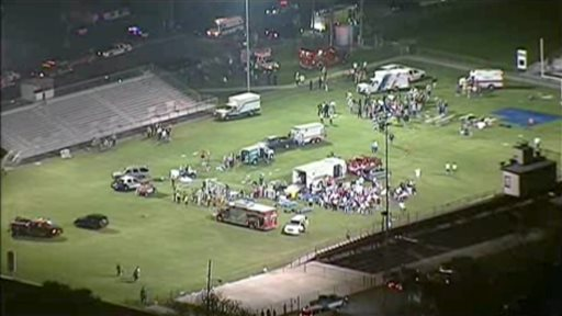 This video image provided by WFAA-TV shows injured people being treated on the flood-lit the high school football field turned into a staging area after the blast in West, Texas, on Wednesday.
