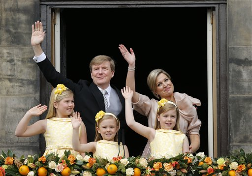 Dutch King Willem-Alexander and Queen Maxima appear on the balcony of the Royal Palace with their children, from left: Catharina-Amalia, Ariane, and Alexia in Amsterdam, The Netherlands on Tuesday.