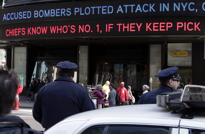 News headlines circle a building in New York's Times Square on Thursday, announcing that the Boston Marathon bombing suspects had planned to blow up their remaining explosives in New York's Times Square, officials said.