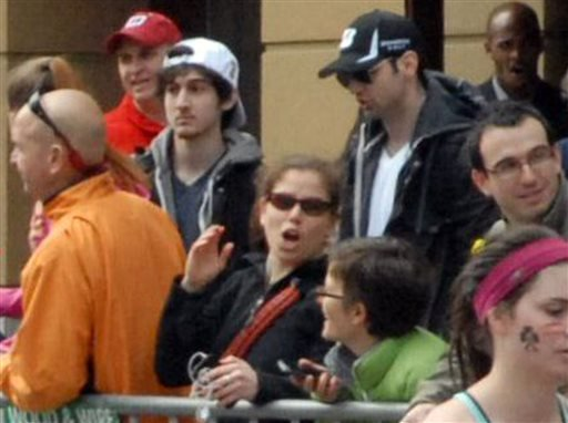 This April 15, 2013, photo provided by Bob Leonard shows bombing suspects Tamerlan Tsarnaev, 26, in black hat, and his brother, Dzhokhar A. Tsarnaev, 19, in white hat, approximately 10-20 minutes before the blasts that struck the Boston Marathon. Some experts in sibling research say the powerful bonds that can develop between brothers may have played a role in the bombings.