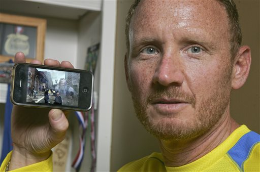 David Green holds up his iPhone with a photo on it he took after the Boston Marathon bombing on Monday, seconds after the bombs exploded, Green pulled out his smartphone and took the photo of the chaos developing a couple hundred yards in front of him -- the smoke, the people running in panic. The Jacksonville businessman then put his phone back in this pocket and went to help the injured. It wasn't until Thursday that Green realized what he had – a picture of suspect Dzhokhar A. Tsarnaev, distinctive in his backward white baseball cap, walking away from the scene.