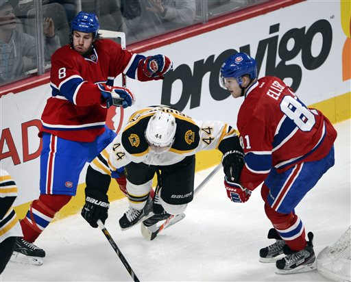 Boston Bruins defenseman Dennis Seidenberg (44) is sandwiched between Montreal Canadiens right wing Brandon Prust (8) and Canadiens center Lars Eller (81) during third-period NHL hockey game on Saturday, April 6, 2013, in Montreal. Montreal won 2-1. (AP Photo/The Canadian Press, Ryan Remiorz) Canada Quebec Montreal hockey;NHL;athlete;athletes;athletic;athletics;Canada;Canadian;competative;compete;competing;competition;competitions;game;games;League;National;play;player;playing;pro;professional;sport;sporting;sports;team Montreal Canadiens Bell Center Centre Bell Carolina Hurric