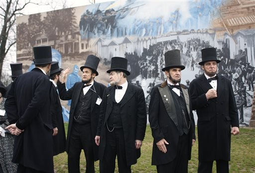 Members of the Association of Lincoln Presenters visit a Civil War mural on their way to the Ohio Statehouse on Friday in Columbus. They were going there to hear a Lincoln speech in the House chamber given by fellow presenter Jerry Payn.