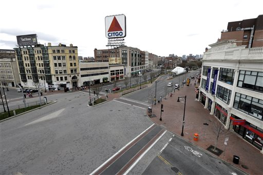 "CORRECTS DATE TO APRIL 19, NOT 18 - The usually busy Kenmore Square in Boston is virtually deserted at lunchtime Friday, April 19, 2013, during a call for ""shelter-in-place"" for Boston and some area communities. Two suspects in the Boston Marathon bombing killed an MIT police officer, injured a transit officer in a firefight and threw explosive devices at police during their getaway attempt in a long night of violence that left one of them dead and another still at large Friday, authorities said as the manhunt intensified for a young man described as a dangerous terrorist. (AP Photo/Elise Amendola) BOSTON MARATHON EXPLOSIONS"