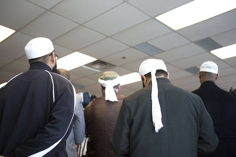 Representatives of Toronto's Islamic community attend a news conference in Toronto as the Royal Canadian Mounted Police announce the arrest of two men accused of plotting a terror attack on rail target, in Toronto, Monday April 22, 2013. (AP Photo/The Canadian Press, Chris Young)