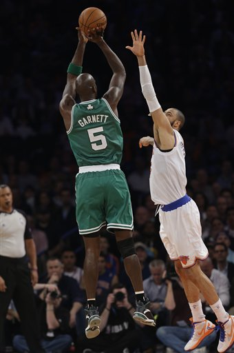 New York Knicks center Tyson Chandler (6) defends as Boston Celtics center Kevin Garnett (5) shoots in the first half of Game 2 of their first-round NBA basketball playoff series in New York, Tuesday, April 23, 2013. (AP Photo/Kathy Willens)