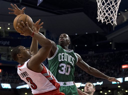 Toronto Raptors guard Kyle Lowry (3) tries to shoot under pressure from Boston Celtics forward Brandon Bass (30) during first-half NBA basketball game action in Toronto, Wednesday April 17, 2013. (AP photo/The Canadian Press, Frank Gunn) basketball;Raptors;Association;athlete;athletes;athletic;athletics;Canada;Canadian;competative;compete;competing;competition;competitions;court;entertainment;event;game;league;National;NBA;player;players;pro;professional;sport;sporting;sports;Toronto