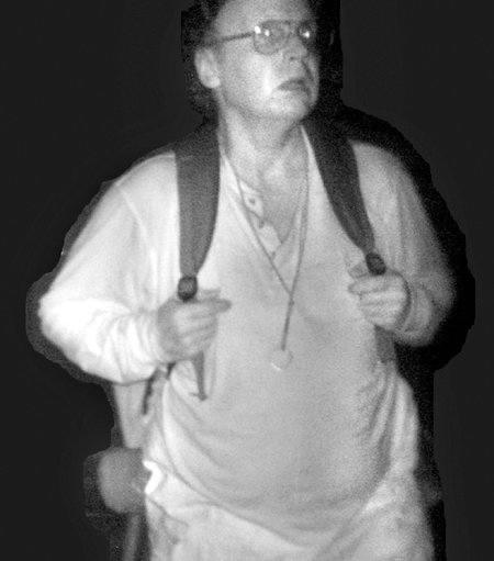 This surveillance camera photo shows a man wearing a backpack, alleged to be Christopher Knight, during a 2011 burglary.