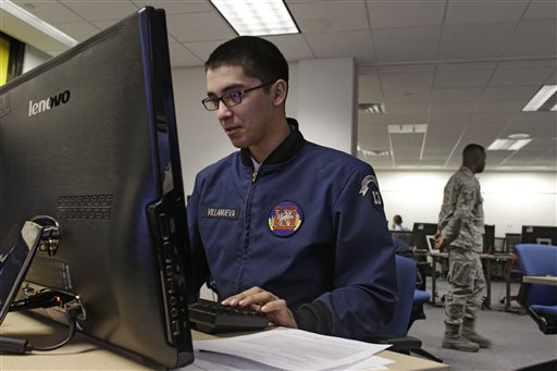 A cadet works at a large computer display in a classroom at the Center for Cyberspace Research at the U.S. Air Force Academy in Colorado Springs, Colo.