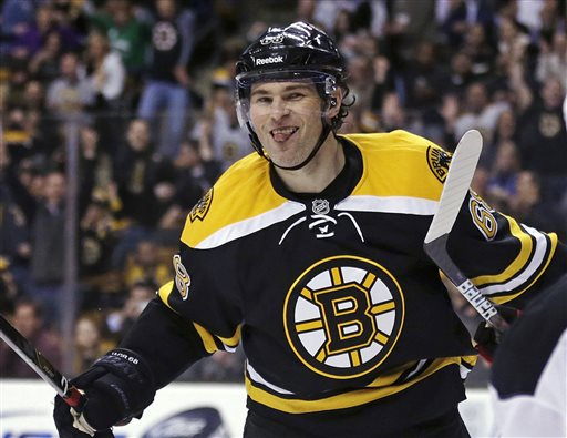 Boston Bruins right wing Jaromir Jagr sticks out his tongue after scoring in the second period of an NHL hockey game against the New Jersey Devils in Boston, Thursday, April 4, 2013. (AP Photo/Charles Krupa)