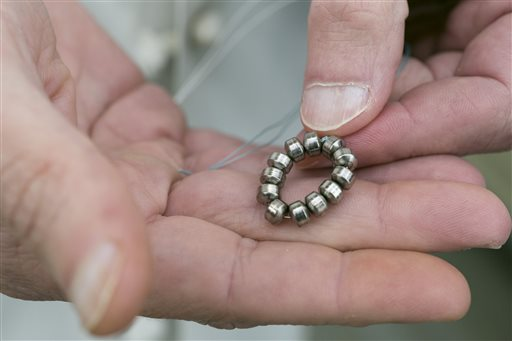The LINX device is a small, flexible band of magnetic beads. When placed around the outside of the esophageal sphincter, the magnetic attraction helps the sphincter stay closed to prevent reflux. Swallowing food will overcome the magnetic attraction and allow food and liquid to pass normally into the stomach.