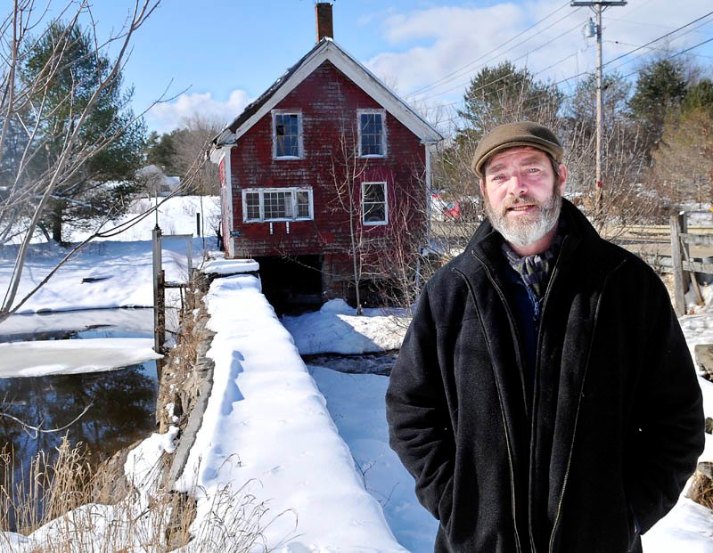 Paul Kelley, the manager of Pleasant Pond Mill LLC, which owns the Clary Lake dam in Whitefield, pictured at the structure on Feb. 26.