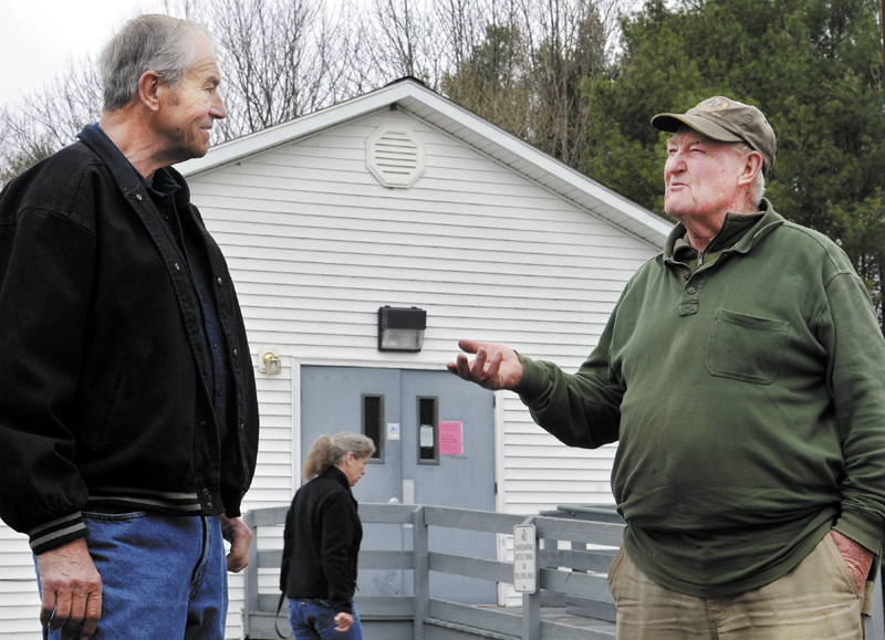 Pittston Selectman Chair Ted Sparrow Jr, right, confers with resident Darrell Weymouth on Wednesday outside the town hall where a special election was being held to determine if Sparrow should be recalled and to elect a new selectman to replace Tim Marks, who resigned from the board in March.