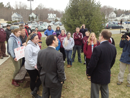 Democrats Rep. Seth Berry, left, and Sen. Seth Goodall meet with students protesting education budget cuts this morning at the State House in Augusta