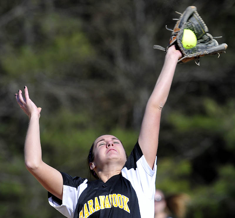 Maranacook Community School's Mariah Vining grabs a popup at third base against Winslow High School on Tuesday in Readfield. Winslow won 4-2. For local roundup, see C3.