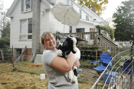 Marcina Johnston, seen last October, has been raising goats with her family in the backyard of their Gardiner home, even though it's in defiance of a city ordinance. Johnson had hoped to change the ordinance to permit small farm animals within such urban areas, but city councilors have not acted on a proposal allowing small livestock within the urban area.