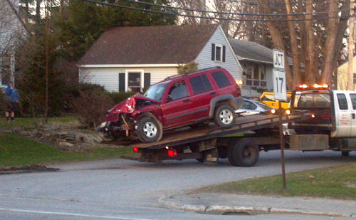 A 2005 Jeep Liberty is taken away from a tow truck Wednesday night in Augusta after police charged the driver, Megan Moone, of Mount Vernon, with drunken driving. The SUV crashed near state police barracks on Hospital Street and hit two utility poles, police said.