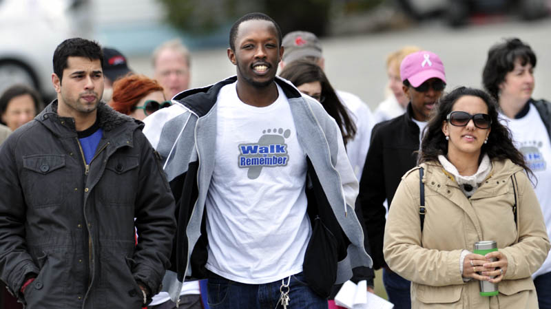Sahil Sanan, left, and Judith Rodriguez accompany Eric Habineza, center, a Rwandan national, during the Walk to Remember on Tuesday in Augusta, to recall the 1994 genocide in Rwanda. The event, sponsored by the Holocaust Human Rights Center of Maine, commemorates the slaughter of a nearly a million residents of the African country.