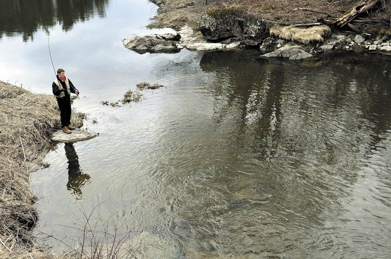 """Wyatt Rush, 18, of Farmingdale, casts a nymph Thursday in a Hallowell stream while learning to fly fish as part of his senior project at Hall-Dale High School. Rush said he had to study the history of fishing, the science of tying flies and practice casting with the hope of catching a few trout. """"I'm still pretty new to this,"""" Rush said while roll casting his line."""