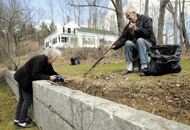 "Polly Peters Blake, 85, and her husband, Bear, 76, clean up the peonies bed Monday outside their Mount Vernon farm. The couple relocated to the town three years ago, Polly said, but she recalls watching a previous owner of the farm plant the bed ""over 40 years ago."""