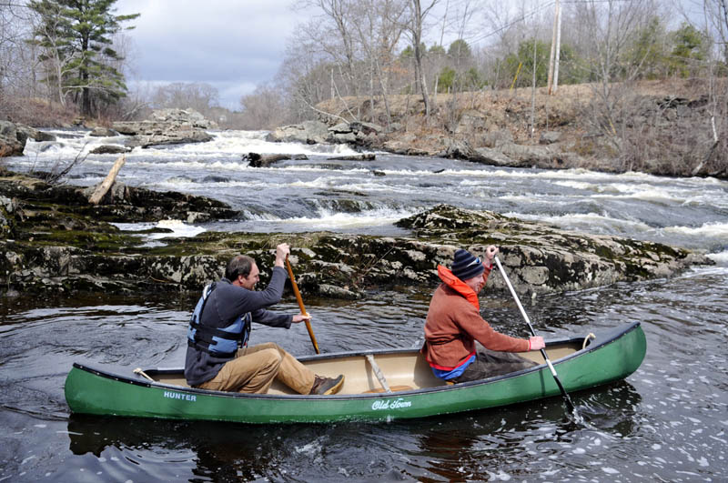 Haskell Padgett, of Whitefield, right, and Nathaniel Wing, of Edgecomb, descend falls on the Sheepscot River in Whitefield Sunday in a 13-foot canoe. The men were paddling down the river, charged with melted snow, to Head Tide in Alna, a 10-mile journey, they said.