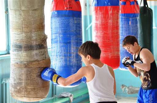 Local boys train at a boxing school in the small Kyrgyz city of Tokmok where bombing suspect Tamerlan Tsarnaev also trained.