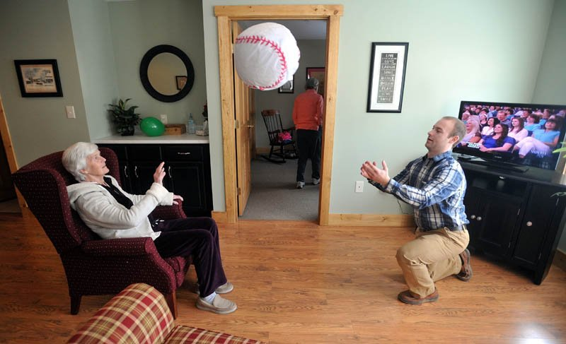 Scott McManaman, right, plays ball with Martha Fabian at Bedside Manor on Belgrade Road in Oakland on Wednesday.