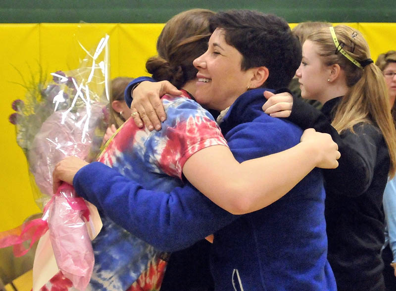 Marisa Weinstein, music teacher at Warsaw Middle School, hugs students after she was presented with the Maine Music Educators Association Educator of the Year award during a surprise assembly at the school on Tuesday.
