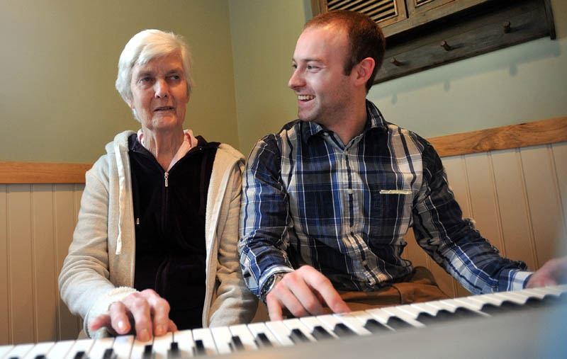 "Scott McManaman, director at Bedside Manor, plays a duet of ""Chopsticks"" with resident Martha Fabian at Bedside Manor on Belgrade Road in Oakland on Wednesday."