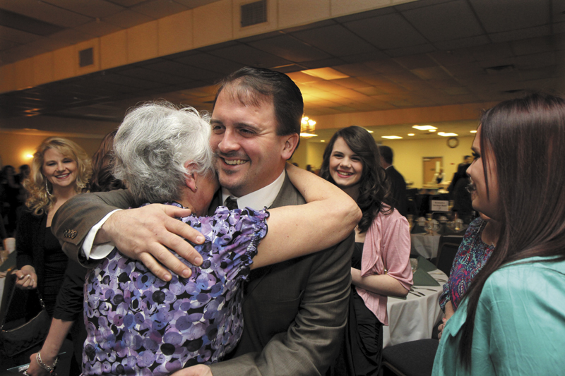 Shawn Michaud of Valley Distributors gets a hug from his mom Eva prior to receiving the Elias A. Joseph Award at the Mid-Maine Chamber of Commerce's annual awards banquet on Thursday night in Waterville. The event was held at the Waterville Elks Banquet & Conference Center.