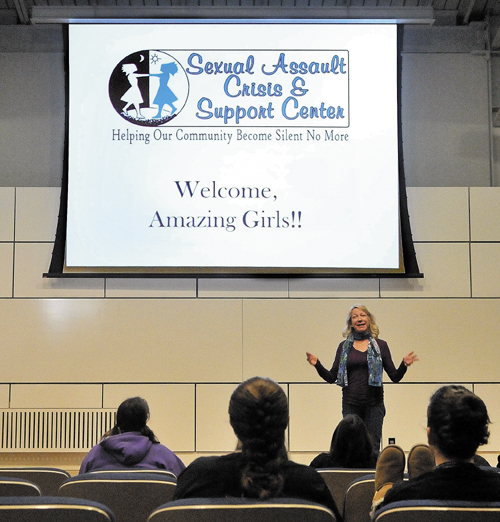 Kathleen Paradis, community educator for the Sexual Assault Crisis and Support center in Winthrop gives a presentation on cyber-hate during the Girls Rock! conference sponsored by Hardy Girls Healthy Women at Colby College on Friday.