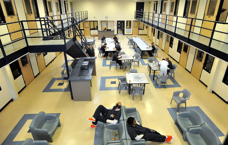 Inmates read and play board games in the day room in the medium security wing at the Somerset County Jail in East Madison on Tuesday.