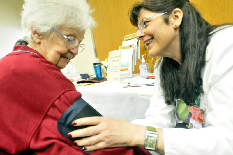 Dorothy Dostie, 91, of Waterville, has her blood pressure checked by Hope Pendexter, a registered nurse at Inland Hospital, at the 16th annual Word of Women's Wellness event, sponsored by Inland Hospital, at Thomas College on Saturday.