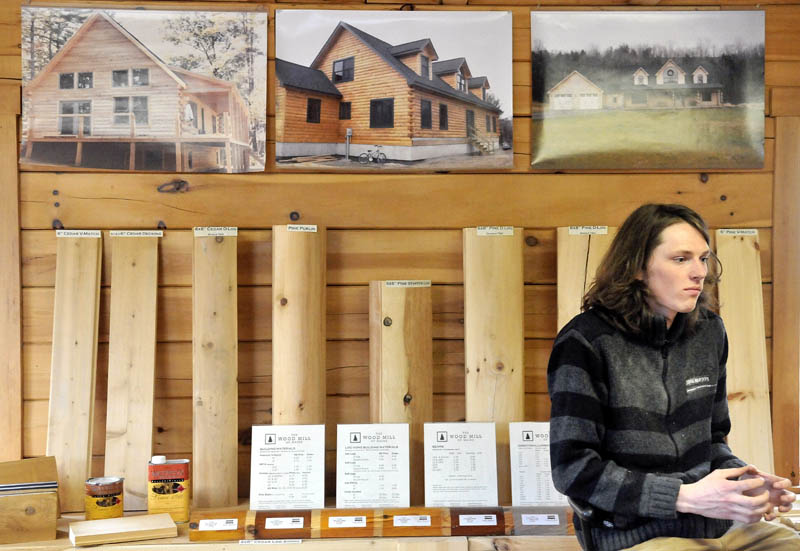 Bjarki Gunnarson sits in front of some of the specialty wood products that his company, The Wood Mill of Maine, which he co-owns with his friend, Josh Saltmarsh, on Mercer Road in Mercer.