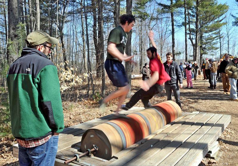 The burling competion at Colby College's annual Muddy Jack & Jill Meet in Waterville on Saturday.
