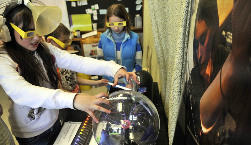 Fifth-graders participate in the first Science, Technology, Engineering and Math Day at Albert S. Hall School in Waterville on Friday.