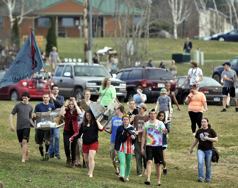 During the first cardboard kayak race at Unity College on Friday, students had one hour to fabricate kayaks from cardboard, tape and plastic, then race them.