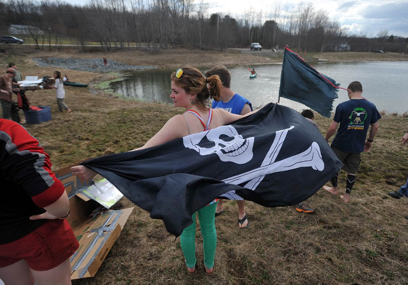 Summer Nay, 20, flies her skull and crossbones flag before the first cardboard kayak race at Unity College on Friday.