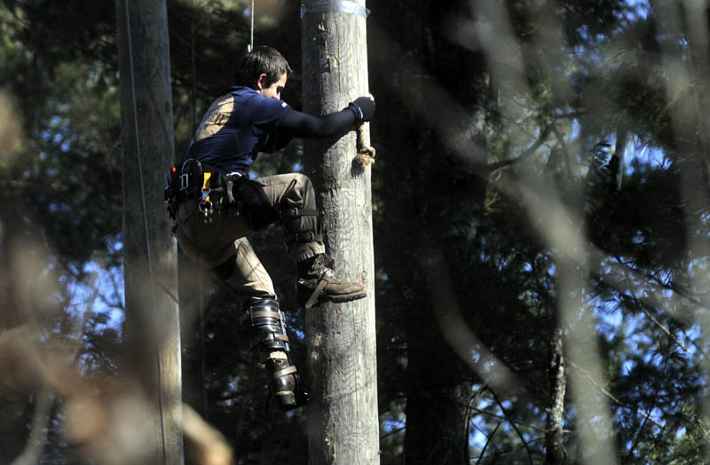 The pole climbing competittion at Colby College's annual Muddy Jack & Jill Meet in Waterville on Saturday.