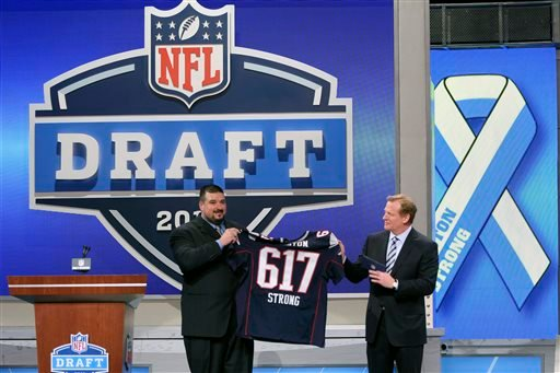 Former New England Patriots guard Joe Andruzzi, who assisted in rescuing in rescue an injured victim from the Boston Marathon attack, and NFL commissioner Roger Goodell honor the victims and first responders of the bombings during the first round of the NFL football draft, Thursday, April 25, 2013 at Radio City Music Hall in New York. (AP Photo/Mary Altaffer)