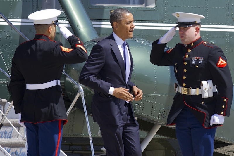 Marines salute as President Barack Obama jogs off of the Marine One helicopter before boarding Air Force One at Andrews Air Force Base, Md., Wednesday April 3, 2013, en route to Colorado. (AP Photo/Jacquelyn Martin)