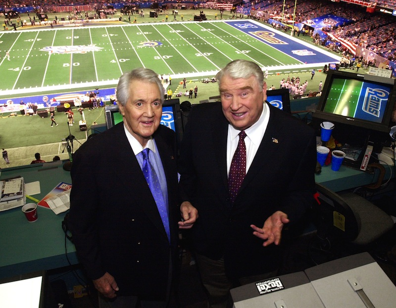 In this Feb. 3, 2002, file photo, Fox broadcasters Pat Summerall, left, and John Madden stand in the booth at Louisiana Superdome before the NFL Super Bowl XXXVI football game in New Orleans. Fox Sports spokesman Dan Bell said Tuesday, April 16, 2013, that Summerall, the NFL player-turned-broadcaster whose deep, resonant voice called games for more than 40 years, has died at the age of 82. (AP Photo/Ric Feld, File) NFL