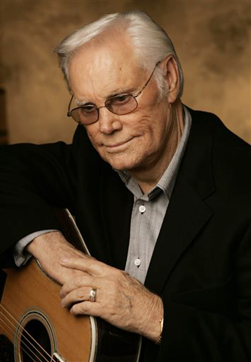 "George Jones is shown here in a 2007 photo. His hits included the sentimental ""Who's Gonna Fill Their Shoes,"" the foot-tapping ""The Race is On,"" the foot-stomping ""I Don't Need Your Rockin' Chair,"" the melancholy ""She Thinks I Still Care,"" the rockin' ""White Lightning,"" and the barfly lament ""Still Doing Time."""