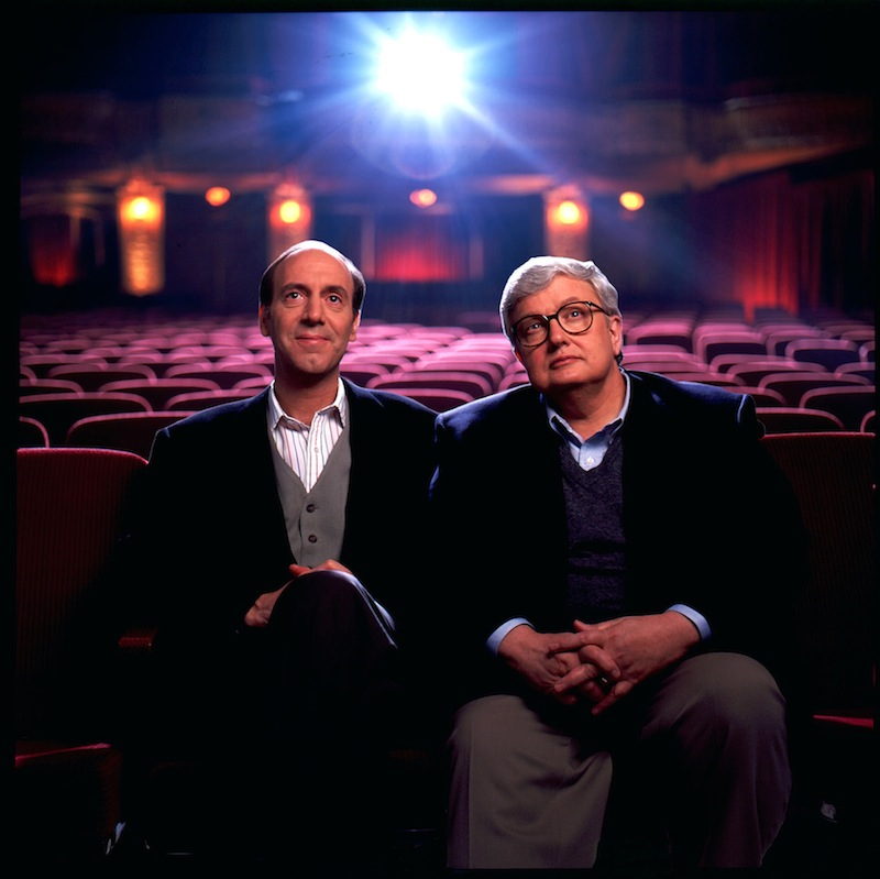 "This undated file photo originally released by Disney-ABC Domestic Television, shows movie critics Roger Ebert, right, and Gene Siskel. Ebert died on Thursday, April 4, 2013. He was 70. Ebert and Siskel, who died in 1999, trademarked the ""two thumbs up"" phrase. (AP Photo/Disney-ABC Domestic Television)"