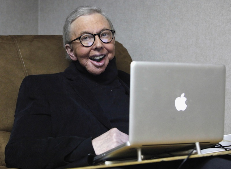 In this Jan. 12, 2011 file photo, Pulitzer Prize-winning movie critic Roger Ebert works in his office at the WTTW-TV studios in Chicago. (AP Photo/Charles Rex Arbogast, File)