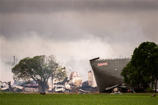 The remains of the the West Fertilizer Co. plant smolder in the rain on on Thursday in West, Texas.