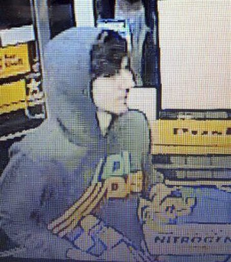This surveillance photo released via Twitter on Friday by the Boston Police Department shows a suspect entering a convenience store that police are pursuing in Watertown, Mass. Police say he is one of two suspects in the fatal shooting of an MIT police officer and tied to the Boston Marathon bombing.