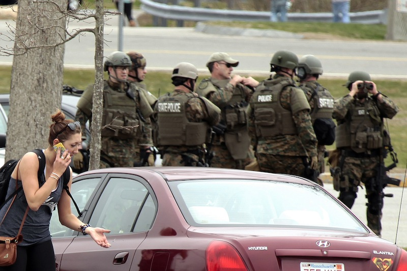 UMASS-Dartmouth students were evacuated from campus on Friday, April 19, 2013as local and state officials investigate the dorm room of Dzhokhar Tsarnaev, 19, one of the two suspects wanted for the Boston Marathon bombing on Monday. Dzhokhar Tsarnaev was registered as a student at the University of Massachusetts Dartmouth, the school said. The campus closed down along with colleges around the Boston area. (AP Photo/Standard Times, Peter Pereira) crime;terrorism;bomb;investigation;police;military