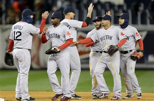 Boston Red Sox players celebrate their 7-4 win over the New York Yankees in a baseball game at Yankee Stadium in New York, Wednesday, April 3, 2013. From left are first baseman Mike Napoli (12), left fielder Jackie Bradley Jr., third baseman Will Middlebrooks, second baseman Dustin Pedroia, right fielder Shane Victorino and shortstop Jose Iglesias. (AP Photo/Kathy Willens)